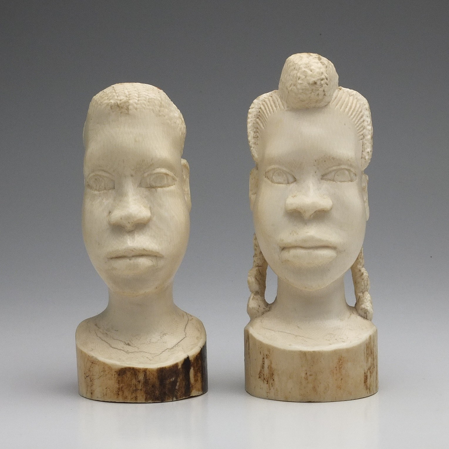 'Two African Carved Ivory Busts'