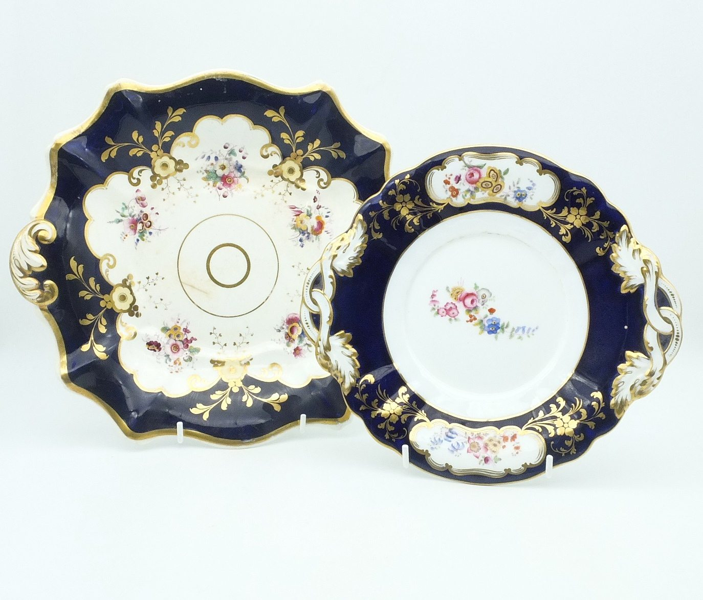 'Two Early Victorian Hand Painted and Gilded Porcelain Plates'