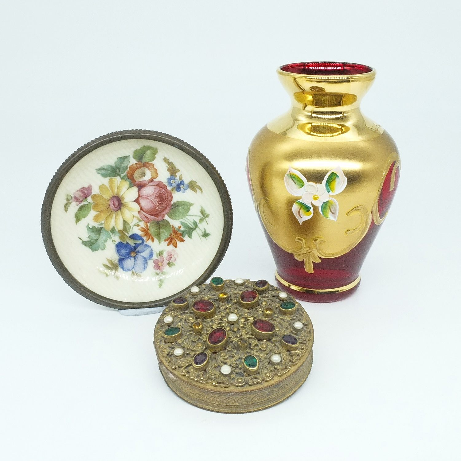 'Decorative Antique Compact with Ostrich Feather Pad, Hand Painted and Gilded Ruby Glass Vase and a Small Floral Porcelain Dish'