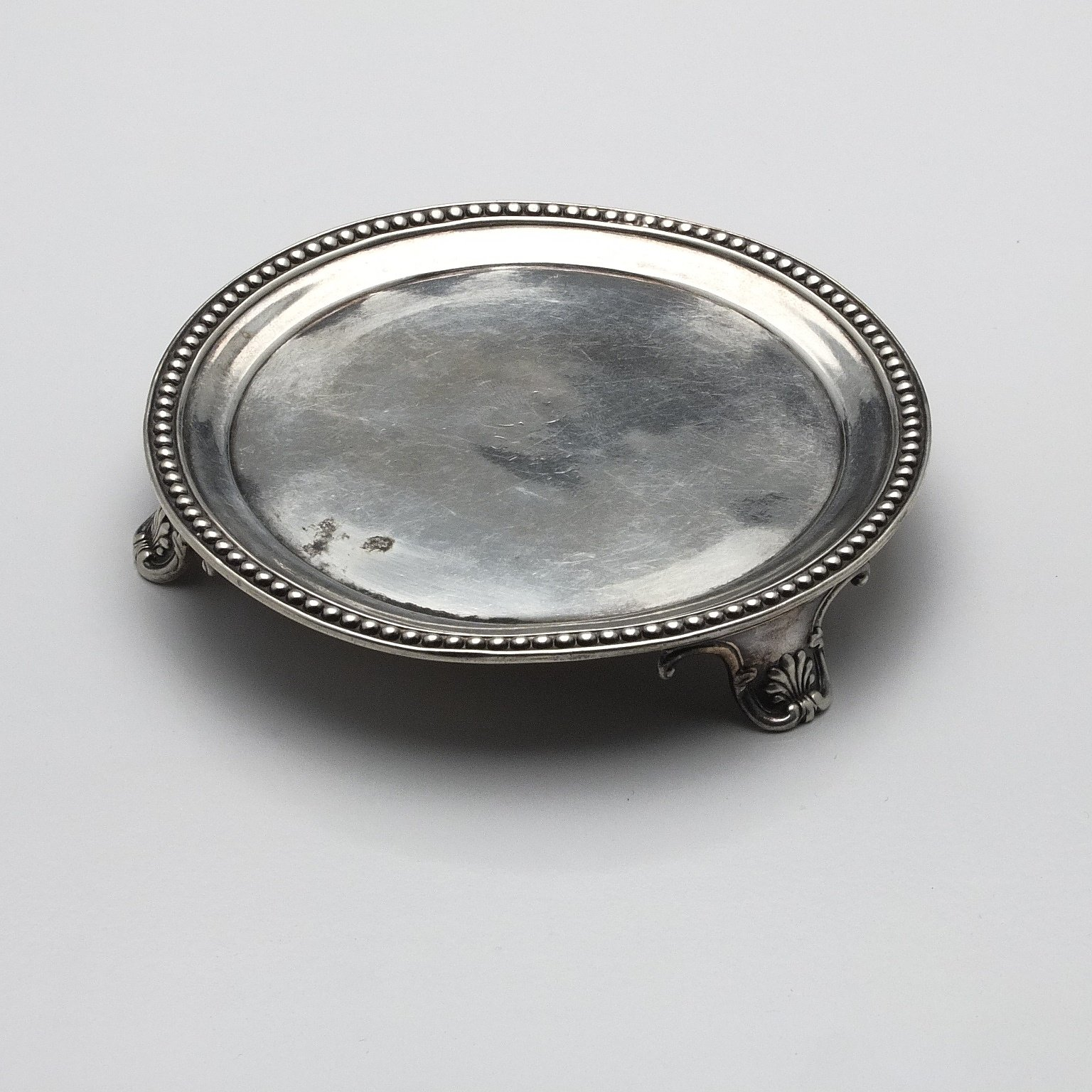 'Georgian Sterling Silver Chased Card Waiter with Kings Pattern Feet'