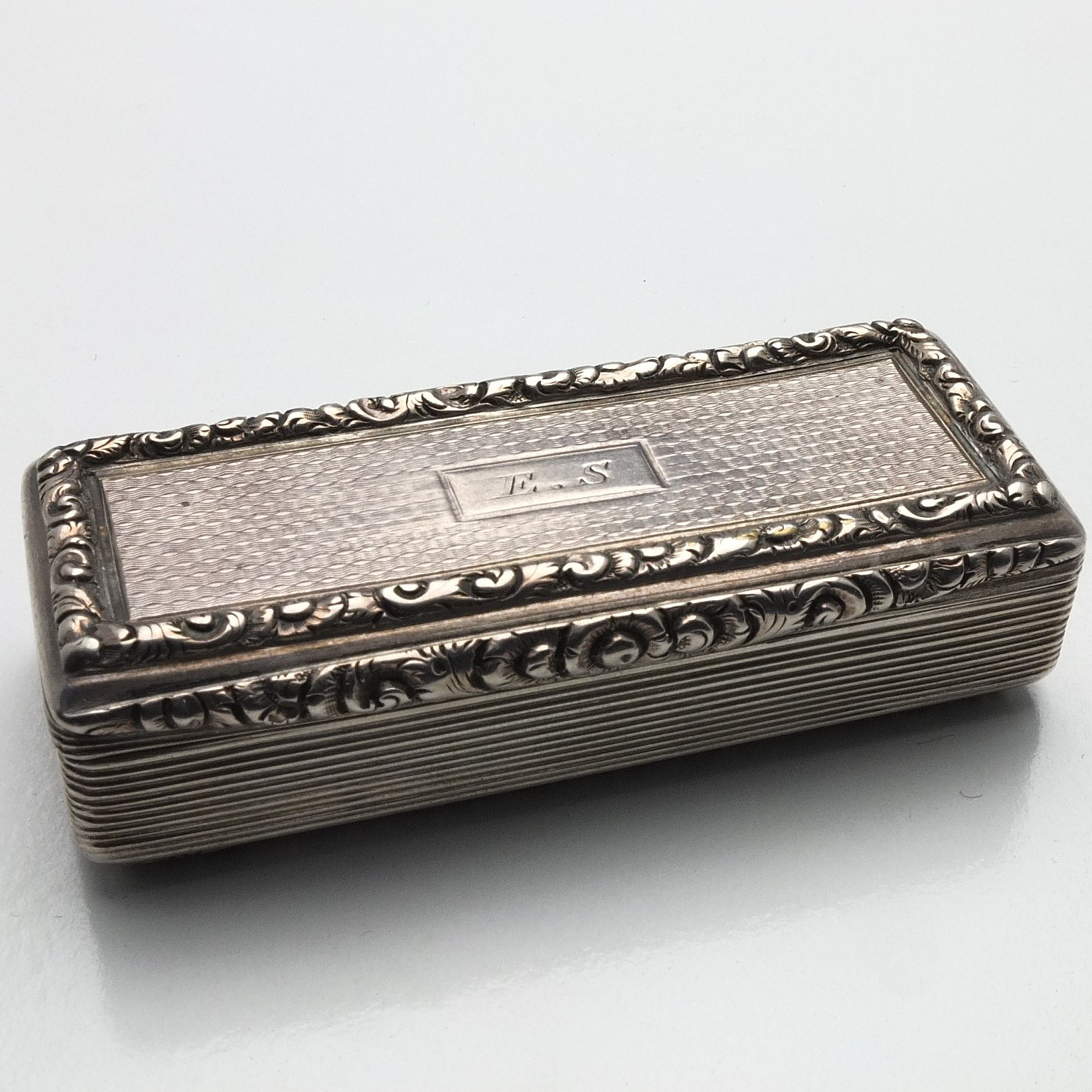 'George III Monogrammed Sterling Silver Engine Turned and Chased Snuff Box William Pugh Birmingham 1809'