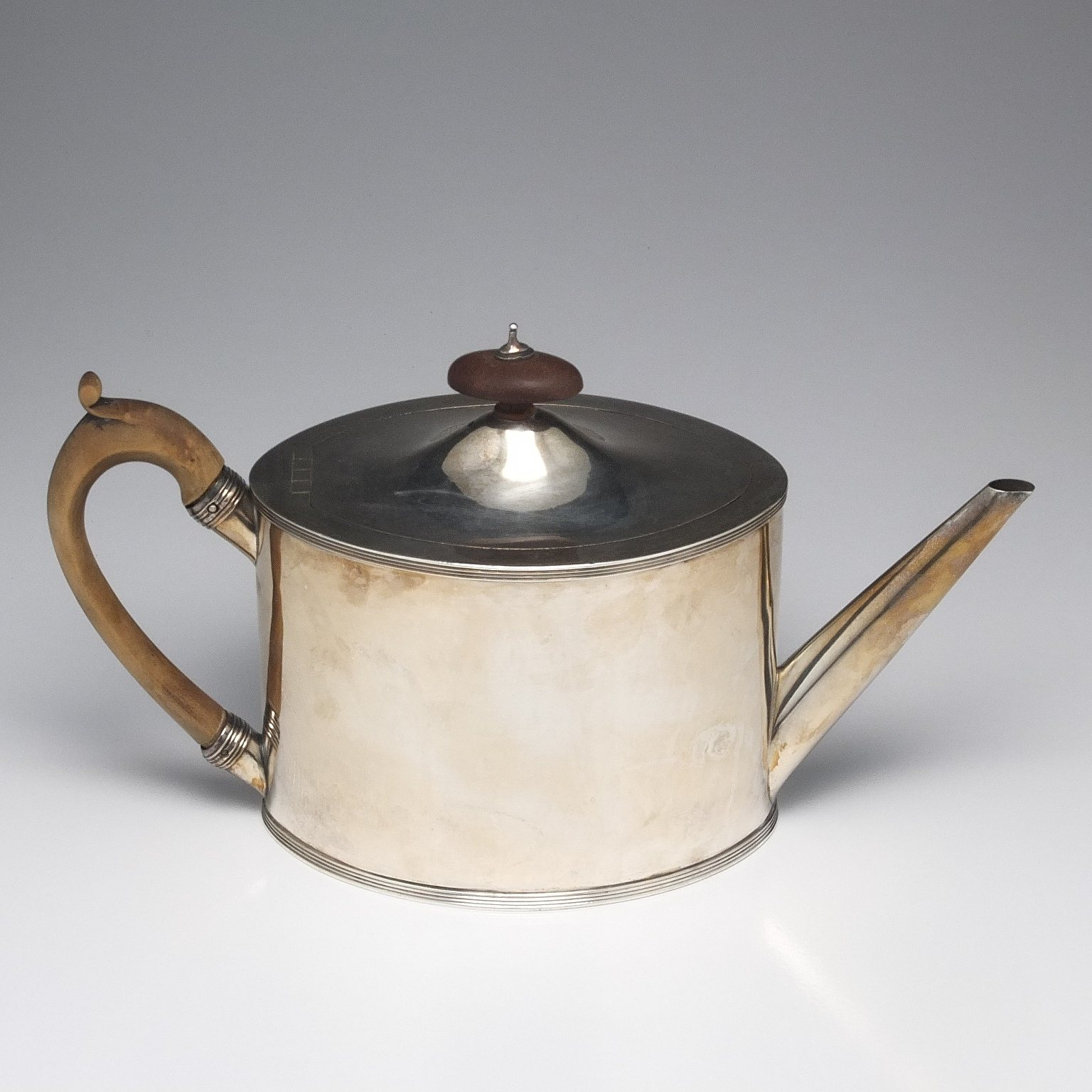 'George III Sterling Silver Teapot and Trivet Henry Chawner London 1790'