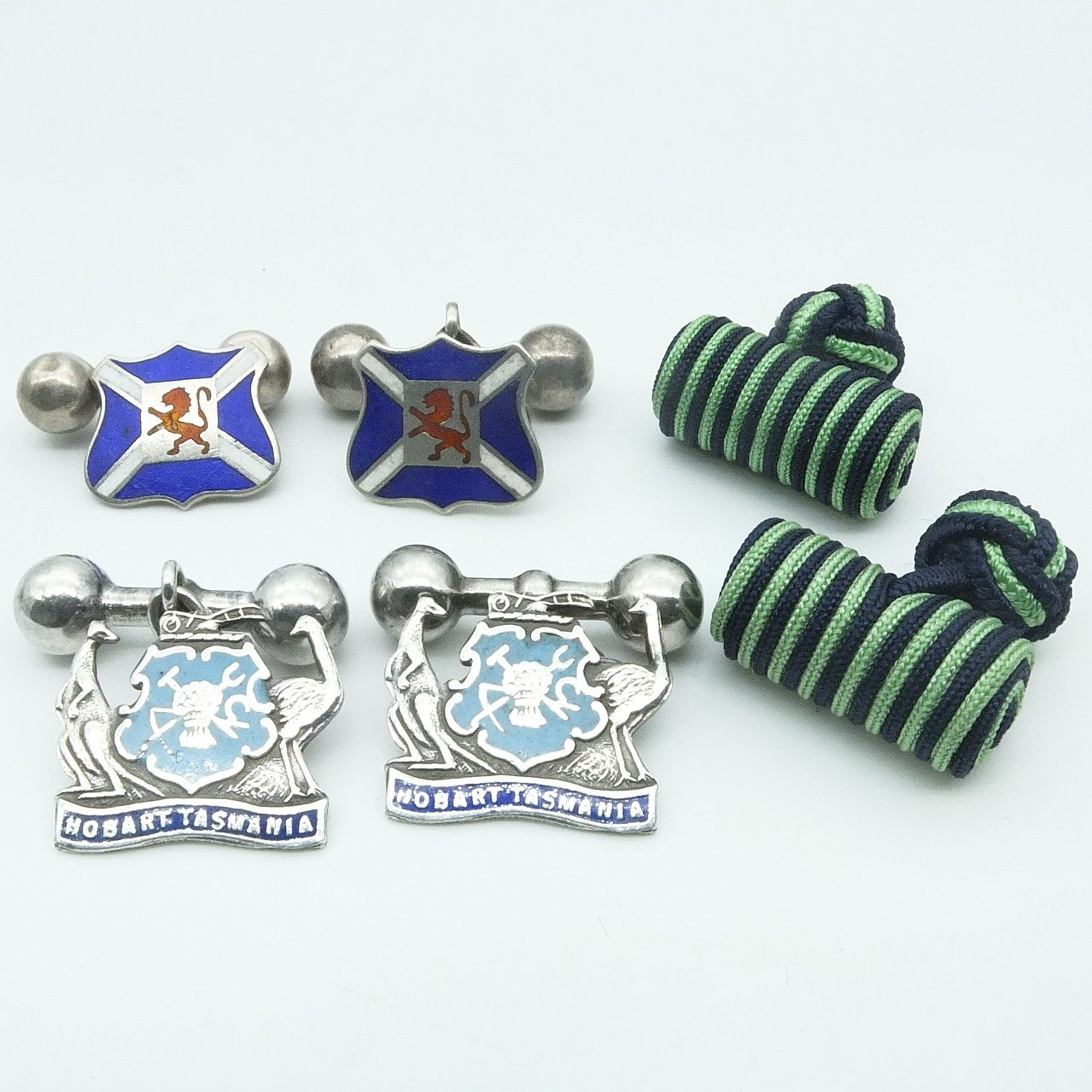 'Two Pairs of Crested Sterling Silver and Enamel Cufflinks and Another'