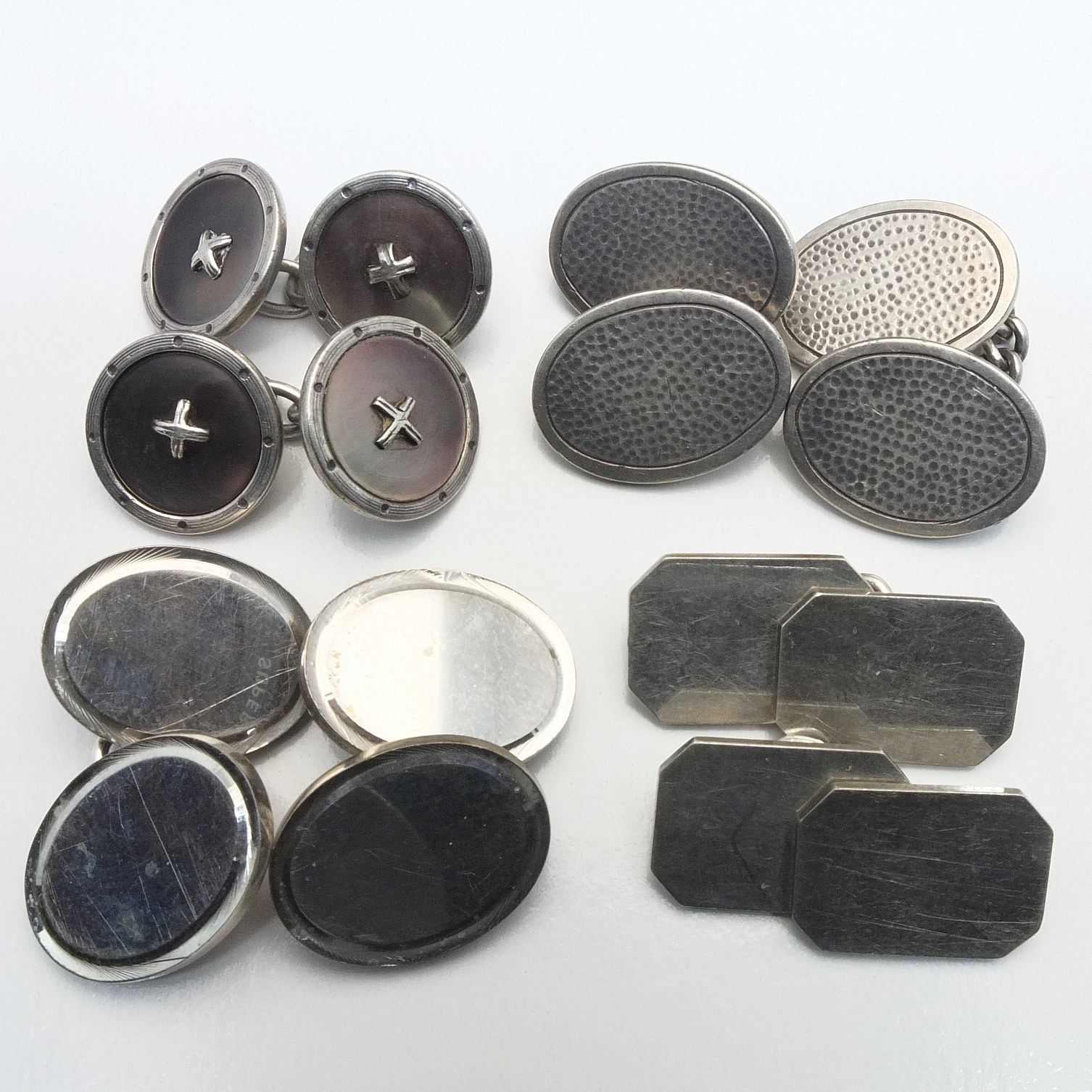 'Four Pairs of Sterling Silver Double Cufflinks'