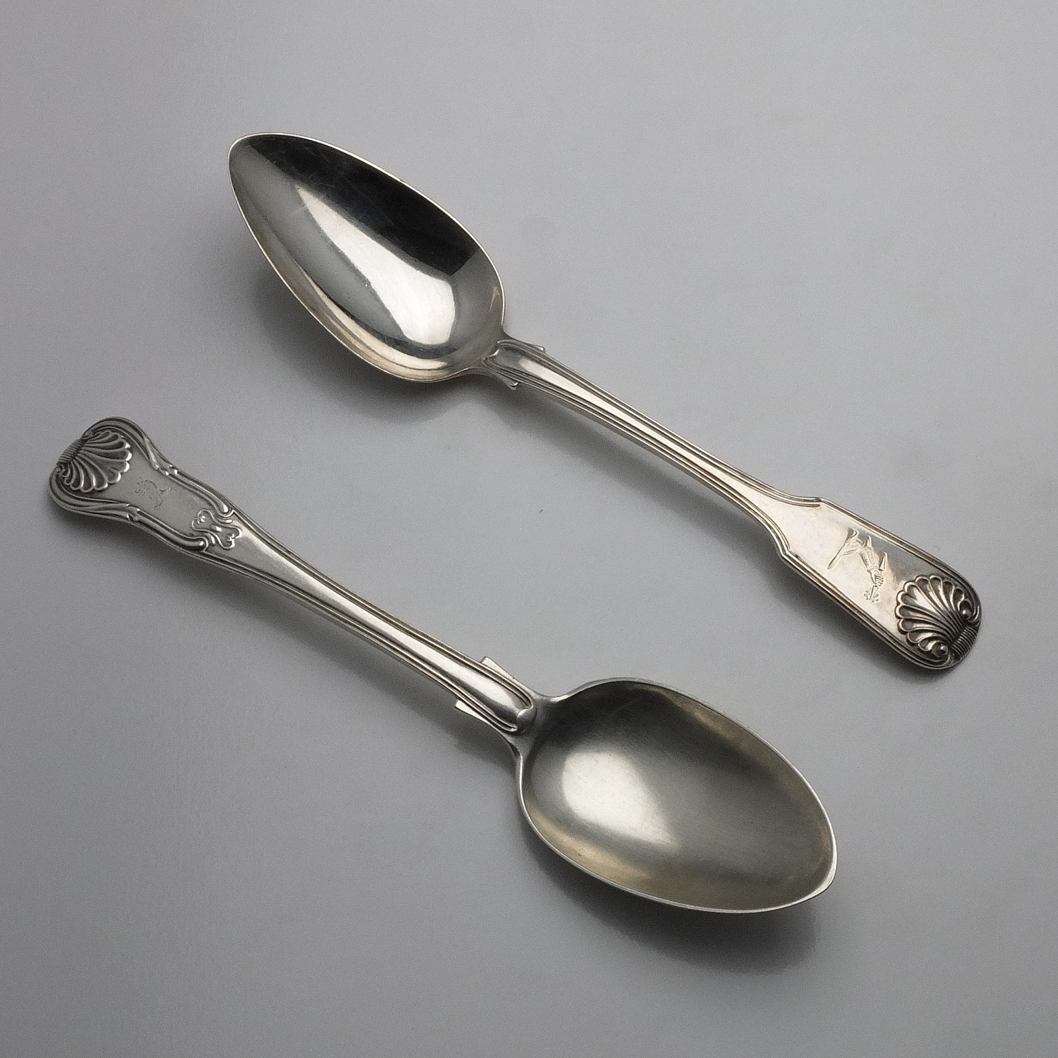 'Two Crested Sterling Silver Table Spoons Richard Pearce London 1819 and Charles Boyton II London 1891'