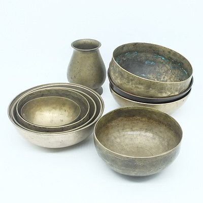 Group of Graduating Brass Bowls and a Vase