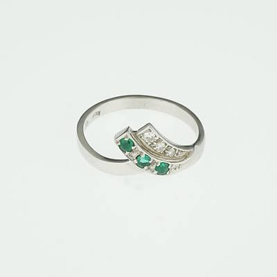 18ct White Gold Ring with Three Round Fine Grade Emeralds And Three Round Brilliant Cut Diamonds