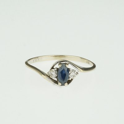 18ct White Gold Marque Medium Blue Sapphire and Two Small Diamonds
