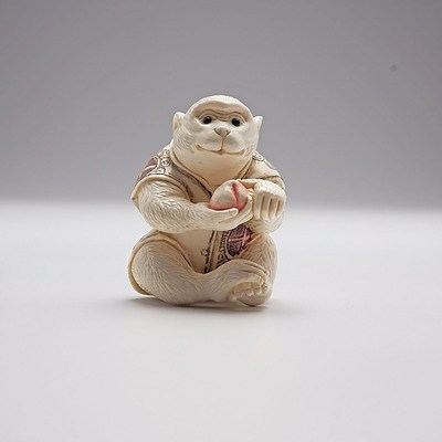 Japanese Carved and Stained Ivory Netsuke of a Monkey