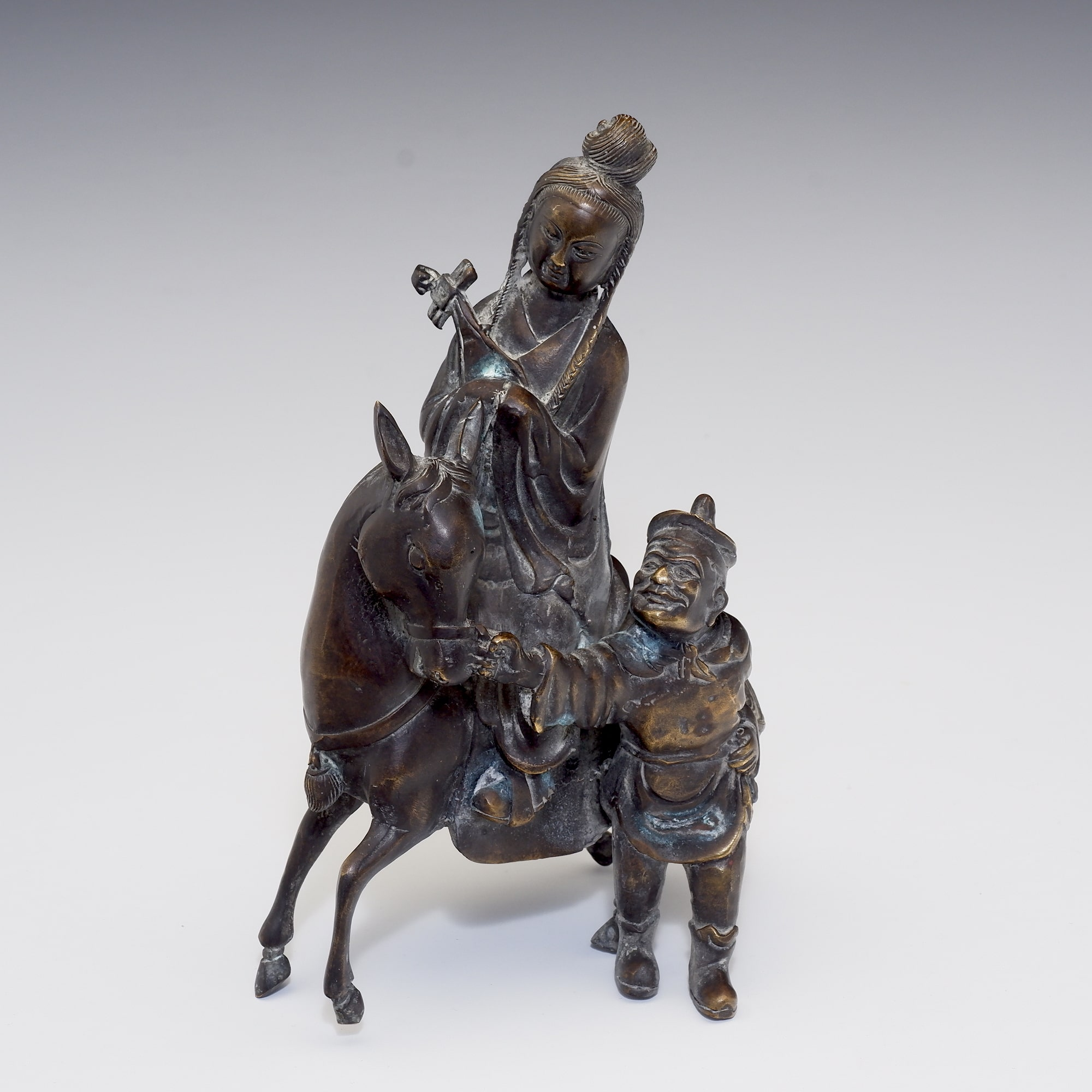 'Chinese Bronze Figure of a Musician on Horseback with Attendant'