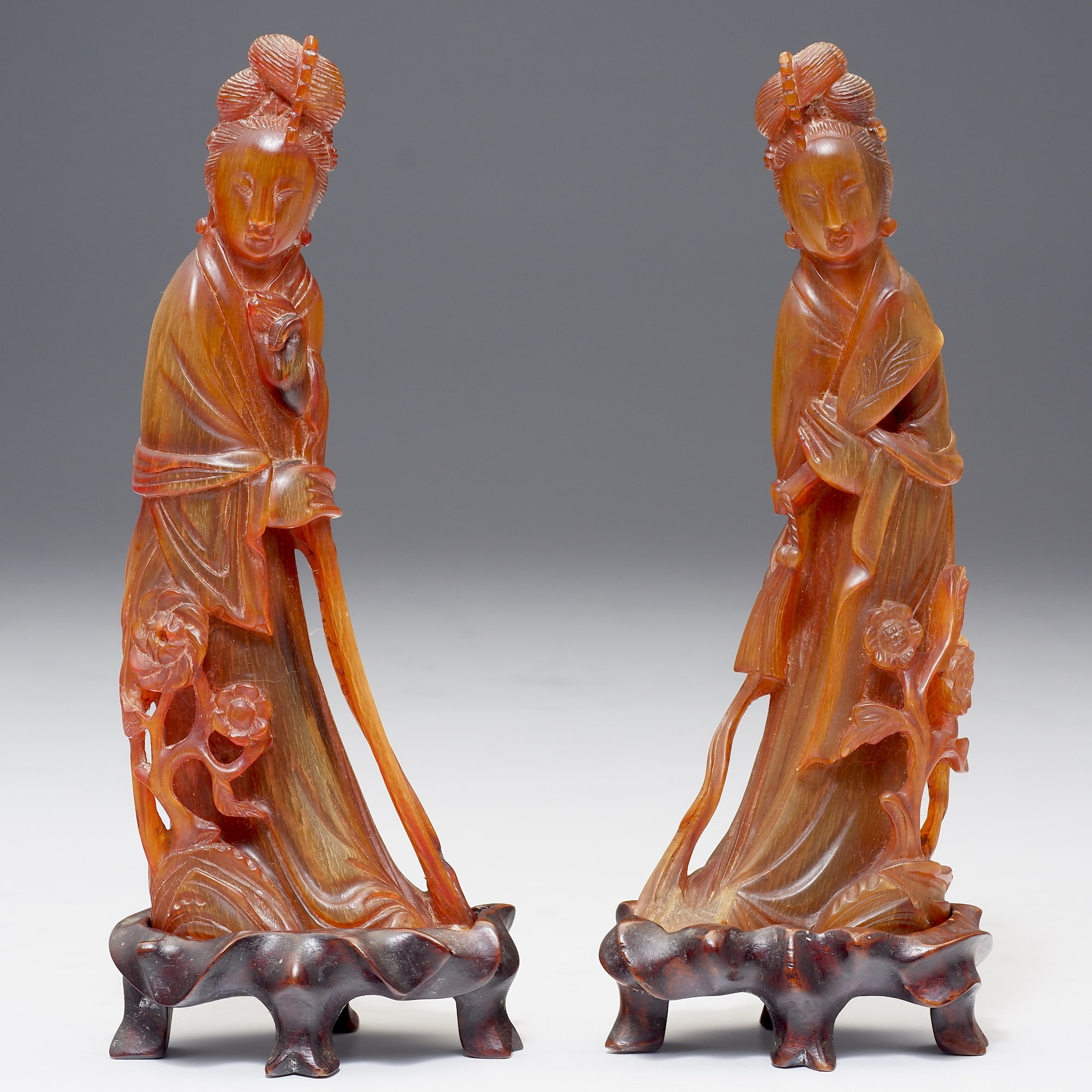 'Pair of Chinese Carved Horn Figures of Guanyin on Fitted Hardwood Stands'