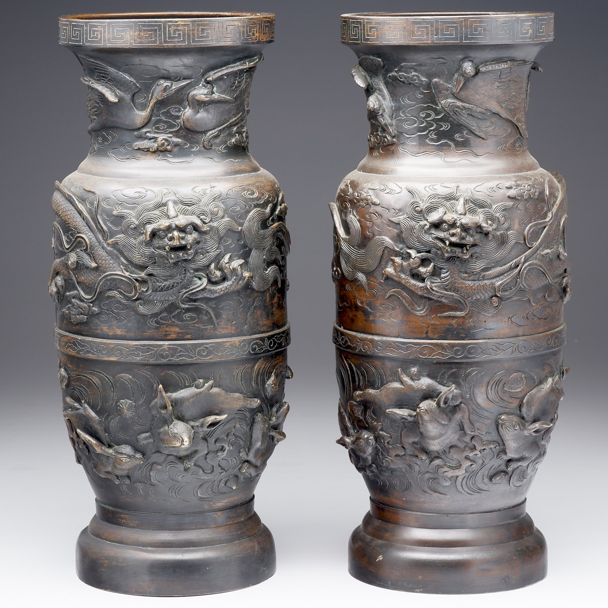 'Impressive Pair of Japanese Relief Cast and Chased Bronze Vases, Meiji Period 1868-1912'