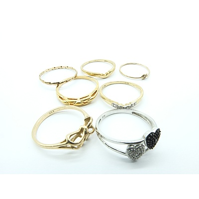 Six 9ct yellow Gold Rings and One 9ct White Gold Ring