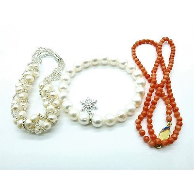 Two Fresh Water Pearl Bracelets and a Stand of Pink Coral