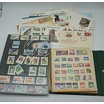 Large Collection of Stamps Including Stamps from Australia, Indonesia and Various First Day Issues