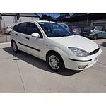 11/2004 Ford Focus LX LR 5d Hatchback White 1.8L