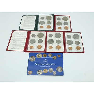 Six Uncirculated Coins Sets, Including 1984 Coin Set in Yellow Plastic