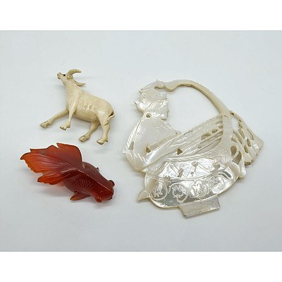 Three Small Figurines and Collectables Including an Ivory Buffalo, Agate Fish and a Mother of Pearl Carving