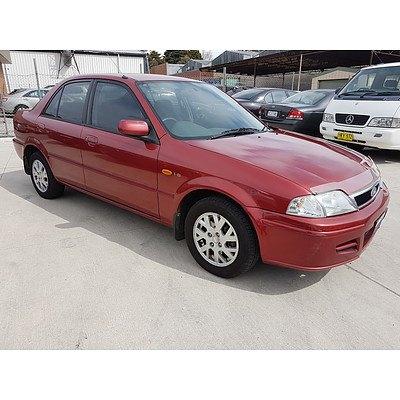 9/2001 Ford Laser GLXi KQ 4d Sedan Red 1.8L