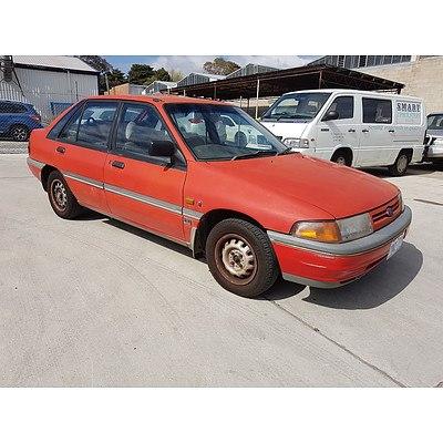 8/1991 Ford Laser GHIA KF 5d Hatchback Red 1.8L