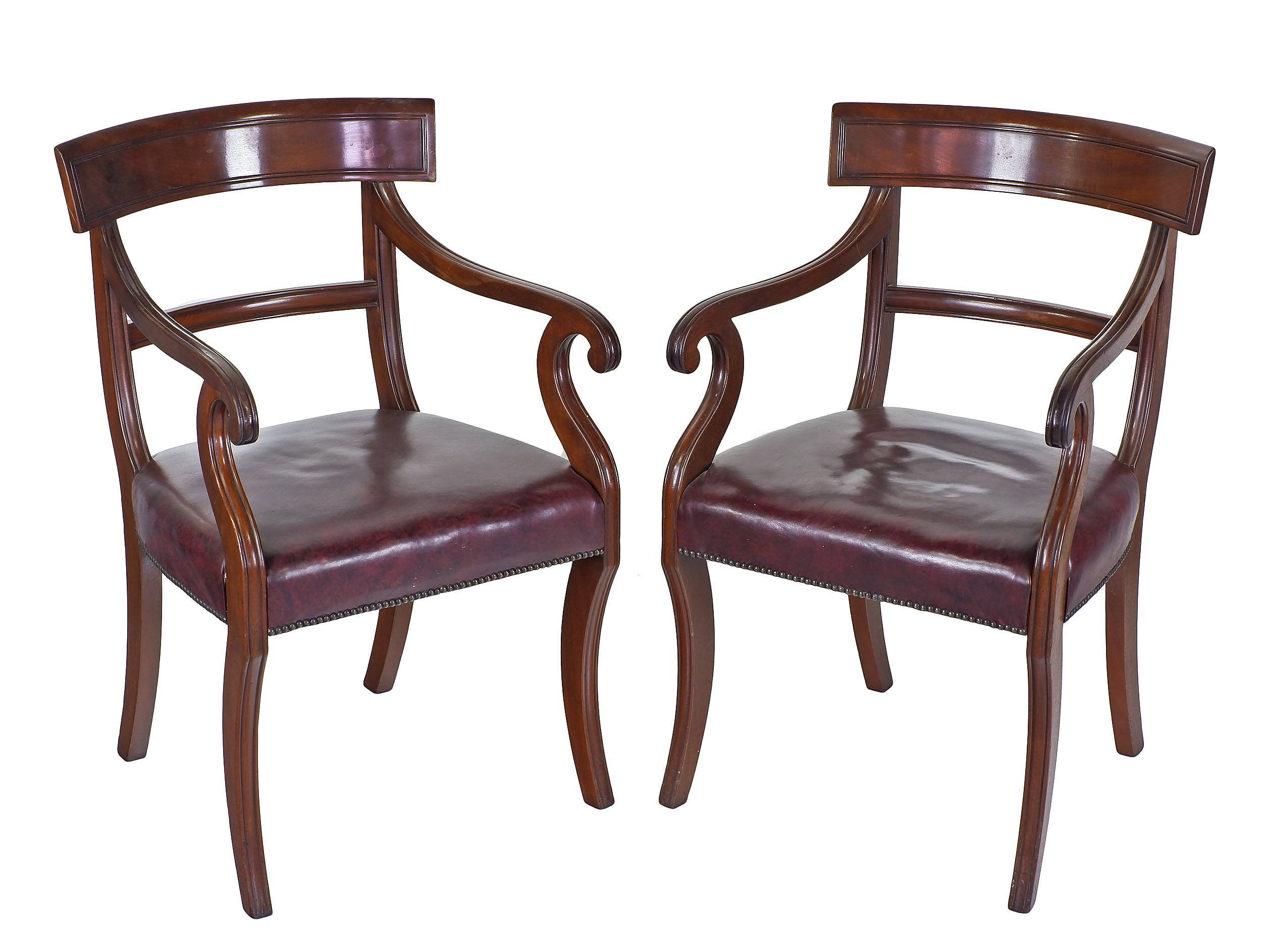 'Pair of Regency Mahogany Arm Chairs with Sabre Legs and Scrolled Arms 19th Century'