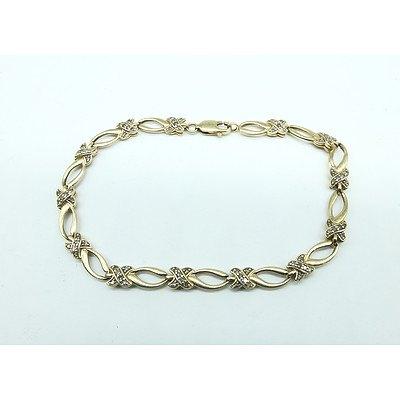 "10ct Yellow Gold Bracelet with Thirteen Diamond Set ""X"" Shape Links"