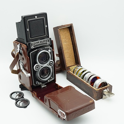 German Rolleiflex Synchro Compur Camera with Leather Rolleiflex and Seven Filters