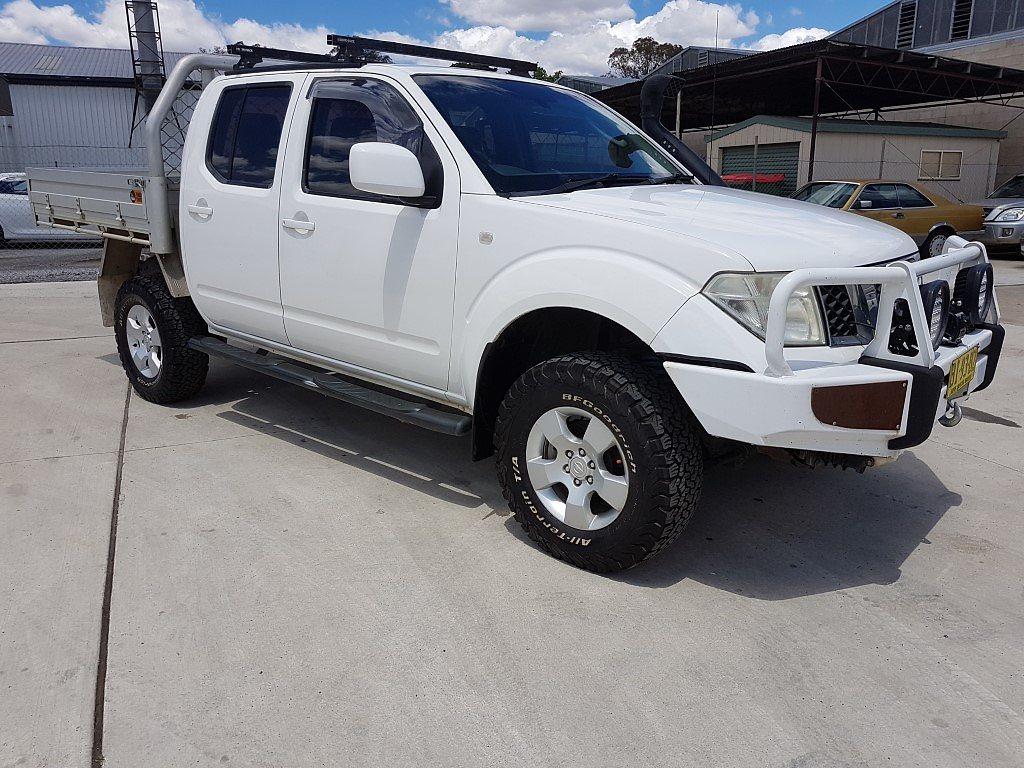 2/2011 Nissan Navara ST (4x4) D40 Dual Cab P/up White 2 5L
