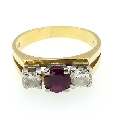 18ct Yellow and White Gold Angus and Coote Ring with Ruby and Round Brilliant Cut Diamonds Ring in Four Claw Setting