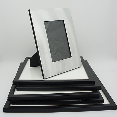 Five Assorted Black Photo Frames and One Metallic Photo Frame
