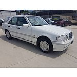 9/1997 Mercedes-Benz C200 Classic W202 4d Sedan White 2.0L
