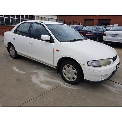 3/1998 Mazda 323 Protege Shades  4d Sedan White 1.8L