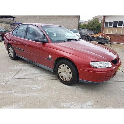 5/2001 Holden Commodore Executive VX 4d Sedan Red 3.8L