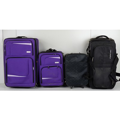 Group of Four Suitcases