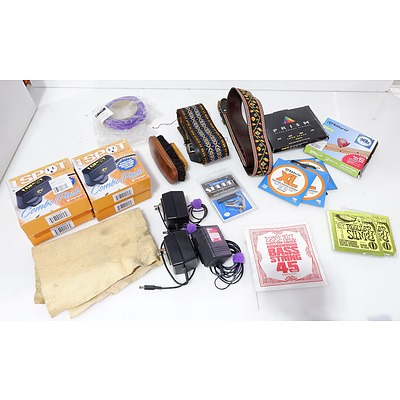 Large Group of Guitar Accessories Including Guitar Strings, Bass Guitar Strings, Straps, Capo, Power Supplies and More