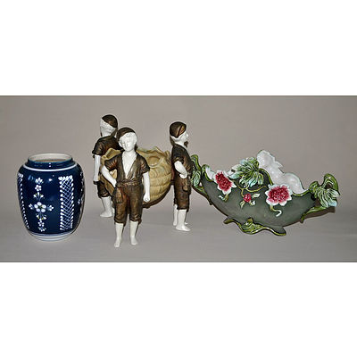 Austrian Amphora Porcelain Centrepiece. Conch shell supported by three fishermen, painted in bronze & yellow. Incl. an Eichwald earthenware compressed oval vase with moulded floral decoration on matt green ground.
