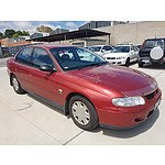 2/2001 Holden Commodore Acclaim VX 4d Sedan Red 3.8L