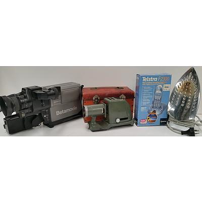 Sanyo Betamovie Video Camera, Fuji Slide Projector, Cordless Phone and Steam Iron