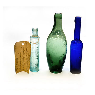 Group 19th C Bottles & Crucibles. Three glass bottles, one green torpedo bottle, one coblat bottle, one marked 'St Jakobs Oel,' one stoneware ginger beer bottle , two ink bottles; & eight crucibles