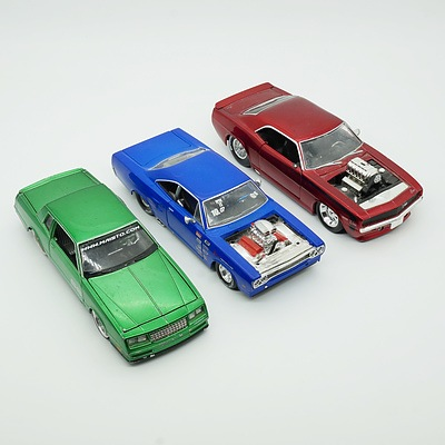 Three 1:24 Model Cars, Including Maisto 1970 Plymouth GTX, Jada 1969 Chevy Camaro and Maisto 1986 Chevrolet Mote Carflo SS