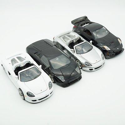 Four Jada 1:24 Model Cars, Including Porsche Carrera GT, Lamborghini Murcielago, Porsche Carrera GT and 2003 Nissan Z
