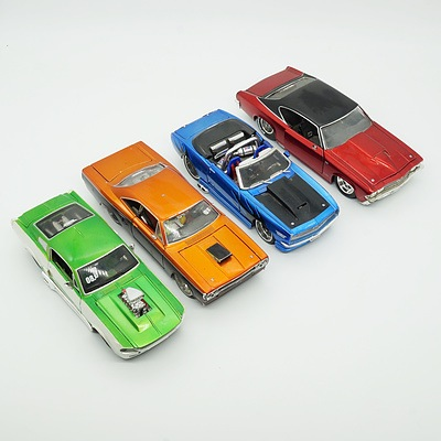 Four 1:24 Model Cars, Including Jada 1969 Chevy Chevelle SS, Maisto 1970 Plymouth GTX, Maisto 1967 Ford Mustang GT and Maisto Chevrolet Camaro SS
