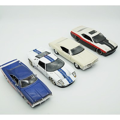Four 1:24 Model Cars, Including Jada Ford GT, Welly Chevrolet Chevelle SS-396, Maisto Dodge Challenger and 1969 Dodge Charger RT