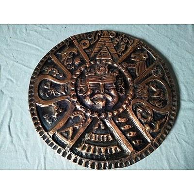 Pressed bronze Aztec wall hanging