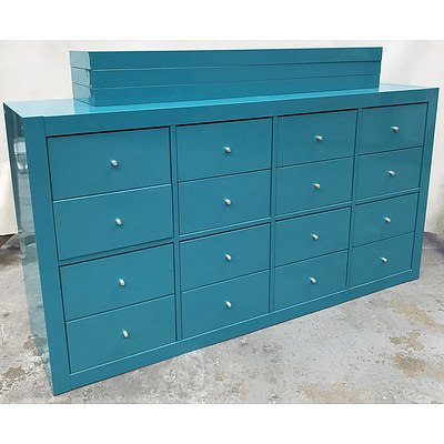 Two Teal 16 Drawer Chest with Six Floating Shelves