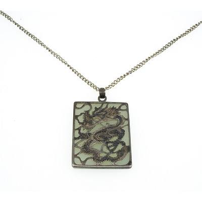 Chinese Square Pendant With Flat Slab of White Jade with Pieced and Engraved Silver Dragon Mount