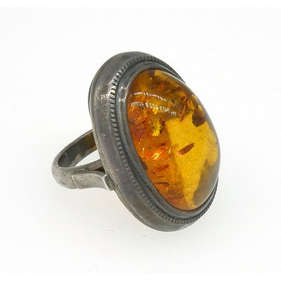 Sterling Silver Ring with Oval Cabochon of Amber