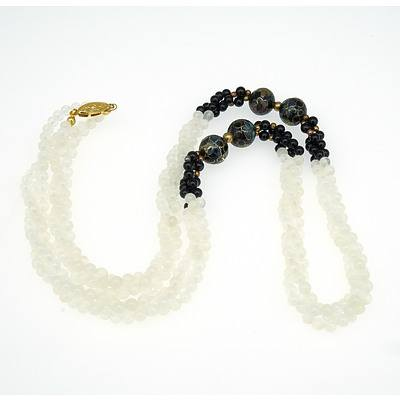 Necklace with Four Cloisonne Beads and Black and Translucent White Chalcedony Beads