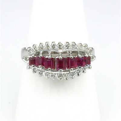 18ct White Gold Ring With Seven Baguette Cut Rubies and Twenty Three Single Cut Diamonds