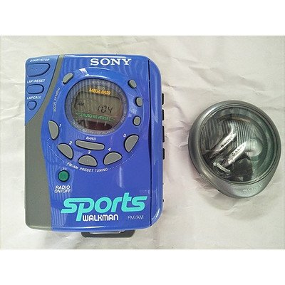 SONY sports walkman (cassette radio) with SONY ear buds in separate case (MINT CONDITION & WORKING)